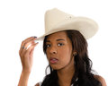 Attractive African American woman in a white hat Royalty Free Stock Photo