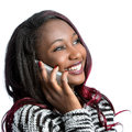 Attractive african teen girl talking on smart phone. Royalty Free Stock Photo
