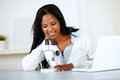 Attractive african woman working with a microscope Royalty Free Stock Photo