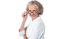 Attractive aged woman looking at you pretty smiling Stock Photos