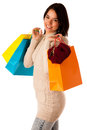 Attractive asian caucasian woman with shopping bags and credit card in her hands isolated over white background Stock Photography