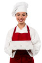 Attractive asian female chef delivering pizza young to the customer Stock Images