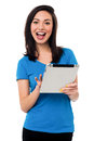 Attractive asian girl browsing on tablet device cheerful young Stock Image