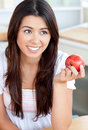 Attractive asian woman eating an apple Royalty Free Stock Photos
