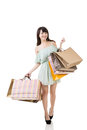Attractive asian woman holding shopping bags full length portrait isolated on the white background Royalty Free Stock Images