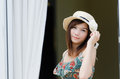 Attractive Asian woman wearing hat Royalty Free Stock Photo