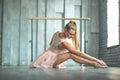 Attractive ballet dancer sitting on floor Royalty Free Stock Photo