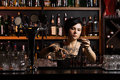 Attractive bartender with a cocktail Stock Images