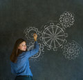 Attractive beautiful business woman student or teacher thinking with turning gear cogs or gears Stock Photos
