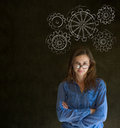 Attractive beautiful business woman student or teacher thinking with turning gear cogs or gears Stock Image