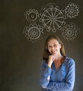 Attractive beautiful business woman student or teacher thinking with turning gear cogs or gears Stock Images