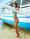 Attractive beautiful woman near the boat Royalty Free Stock Images