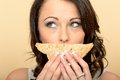 Attractive Beautiful Young Woman Holding a Brown Bread sandwich Royalty Free Stock Photo