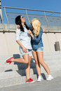 Attractive best friends outdoor friendship standing on the stairs Royalty Free Stock Image
