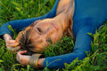 Attractive blond girl lying on grass Stock Photos