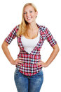 Attractive blond girl smiling with her arms akimbo Stock Photo