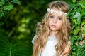 Attractive blond girl in woods close up portrait of cute the Royalty Free Stock Images