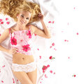 Attractive blond lying on a white blanket Stock Images