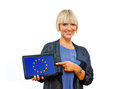 Attractive blond woman holding tablet with european union flag on screen Royalty Free Stock Photography