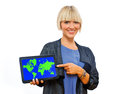 Attractive blond woman holding tablet with world map of the on screen Royalty Free Stock Photos