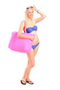 Attractive blond woman in swimsuit posing Stock Photo
