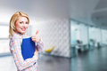 Attractive blonde  businesswoman in front of an office scene Royalty Free Stock Photo