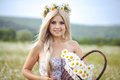 Attractive blonde in chamomile field young woman in wreath surrounded by chamomiles Royalty Free Stock Photography