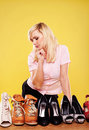 Attractive blonde choosing shoes Stock Photo