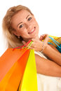 Attractive blonde girl with colorful shopping bags isolated over white background Royalty Free Stock Image