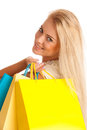 Attractive blonde girl with colorful shopping bags isolated over white background Stock Image