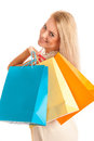 Attractive blonde girl with colorful shopping bags isolated over white background Royalty Free Stock Photography