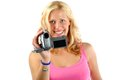 Attractive blonde girl recording with video camera Royalty Free Stock Photos
