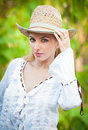Attractive blonde girl with straw hat and white blouse beautiful young woman kaftan in the forest Royalty Free Stock Photography