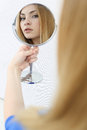 Attractive blonde looks in the mirror Stock Photography