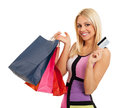 Attractive blonde with shopping bags and credit card beautiful in hand Stock Photography