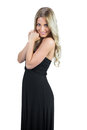 Attractive blonde wearing black dress posing on white background Stock Photos