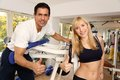 Attractive blonde woman and her trainer in a gym Stock Image