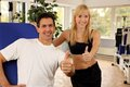 Attractive blonde woman and her trainer in a gym Royalty Free Stock Photos