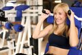 Attractive blonde woman weightlifting in a gym Stock Image