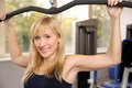 Attractive blonde woman weightlifting in a gym Stock Photography