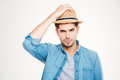 Attractive bristled young man in blue shirt and hat Royalty Free Stock Photo