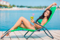 Attractive brunette on the beach Royalty Free Stock Photo
