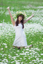 Attractive brunette in chamomile wreath Royalty Free Stock Photography
