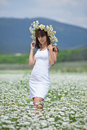 Attractive brunette in chamomile wreath Stock Photo