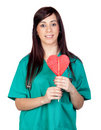 Attractive brunette doctor with a lollipop Stock Photo