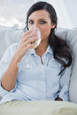 Attractive brunette drinking white wine Royalty Free Stock Photo