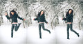 Attractive brunette girl in black posing playing in winter scenery. Beautiful young woman with long hair enjoying the snow Royalty Free Stock Photo