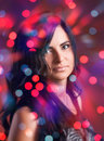 Attractive brunette girl with bokeh lights Stock Photos