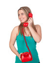 Attractive brunette girl calling with red phone isolated on white background Royalty Free Stock Images