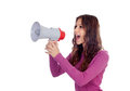 Attractive brunette girl shouting into a megaphone isolated on white background Royalty Free Stock Photos